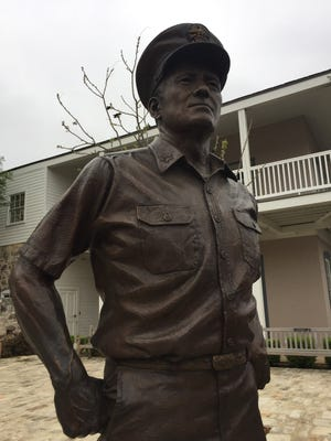 A statue of Adm. Chester Nimitz, fleet commander of the Pacific in World War II, stands before the National Museum of the Pacific War that houses more than 900 war artifacts. The museum is located in Fredericksburg.