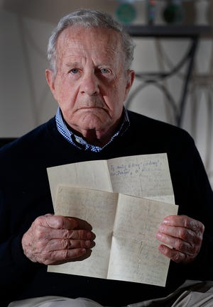 Frank Grunwald holds a photocopy of the letter his mother wrote to his father as she was being led to the gas chamber, a good-bye letter, He was 6 when he and his family were sent to a Nazi prison camp. His mother and brother did not survive. Frank recently donated it to the U.S. Holocaust Museum in D.C.
