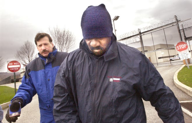 Michael Wright walks away from York County Prison in April 2004 after being sentenced to time-served for his involvement in the 1969 murder of Henry C. Schaad. He said nothing to reporters as he walked to Mount Zion Road and then west on Market Street in the afternoon rain.
