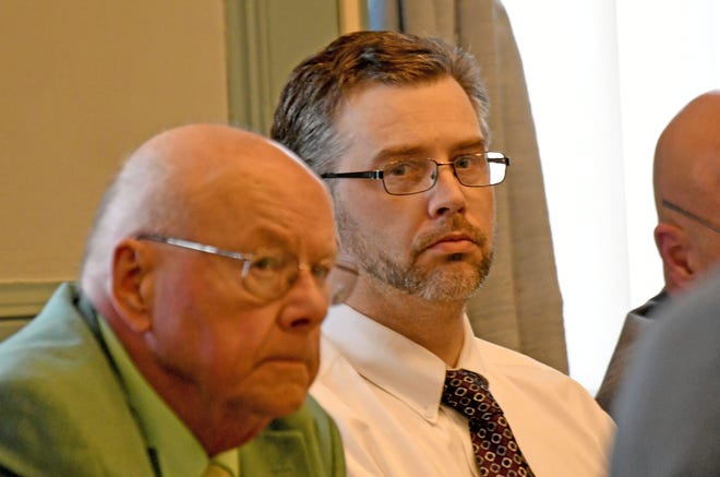Shawn Grate and his attorney Robert Whitney listen to testimony on May 1, 2018 during Grate's murder trial in Ashland County Common Pleas Court.