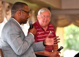 "FSU football coach Willie Taggart and ""the Voice of the Seminoles"" Gene Deckerhoff visited Suntree Country Clun on Wednesday."