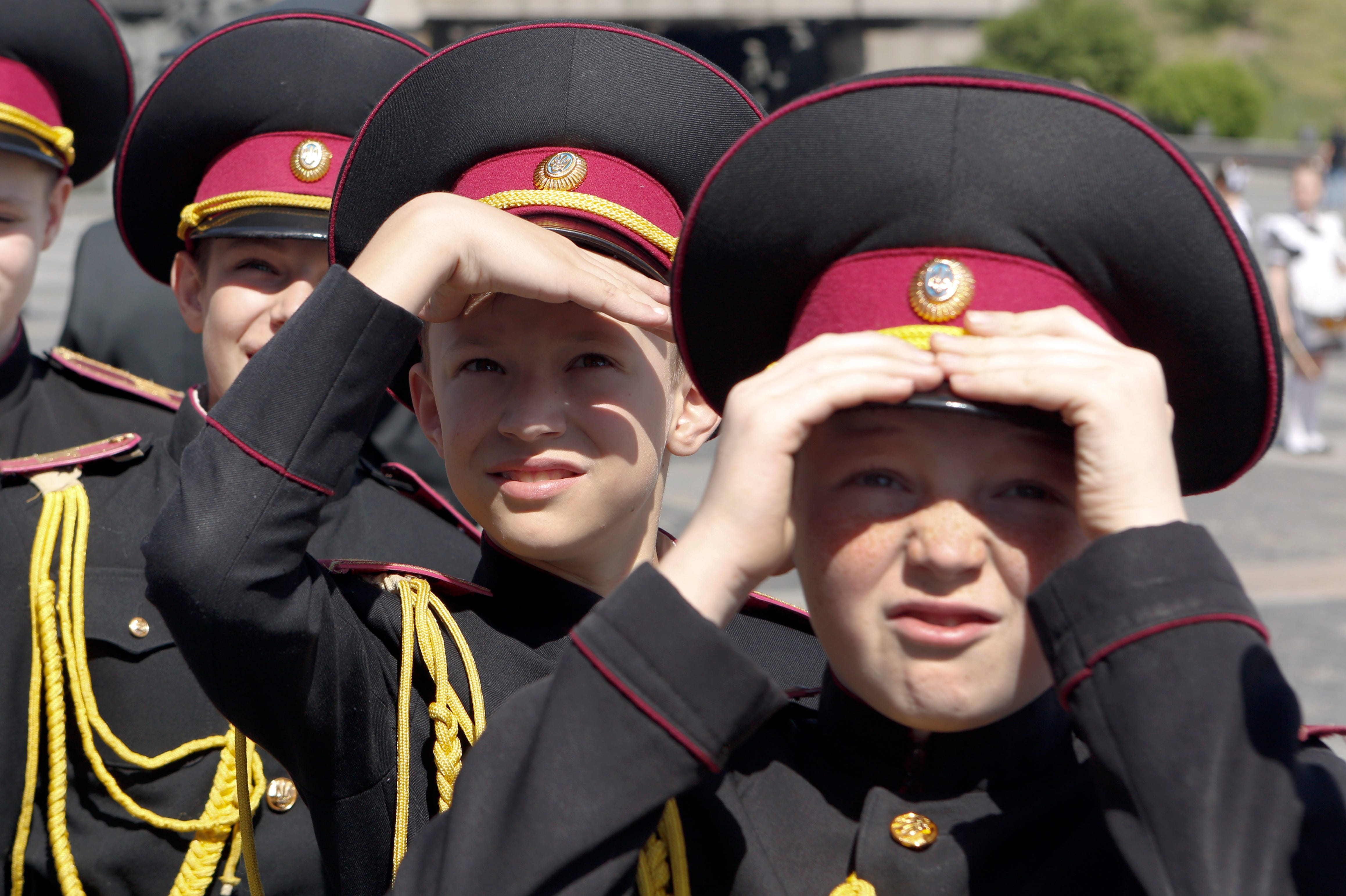 Young cadets watch the parade of Kiev military schools timed to celebrate Victory Day at the WWII memorial in Kiev, Ukraine.