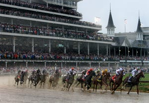 The pack makes its way through the first turn of the 144th Kentucky Derby.