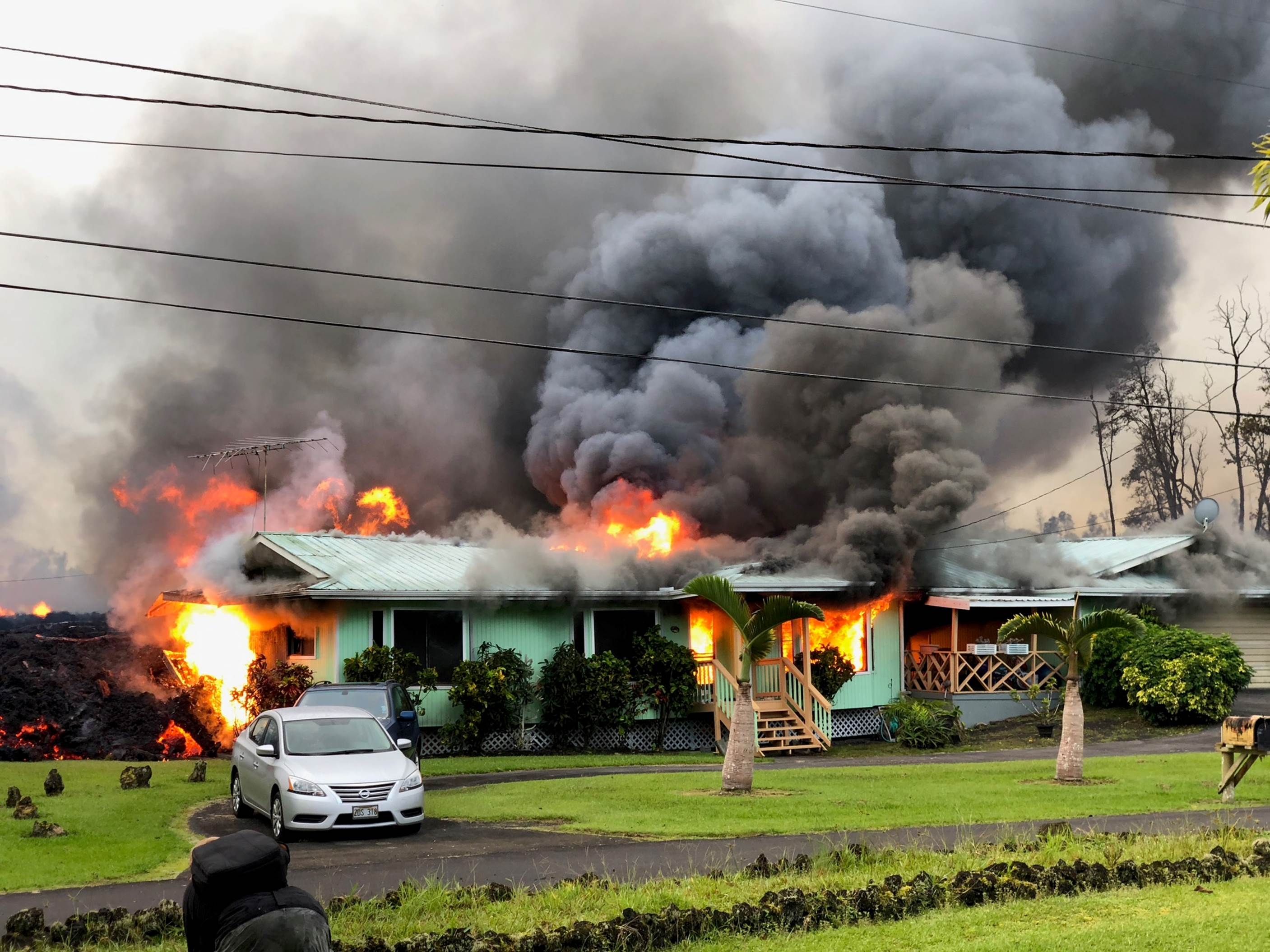 Lava from a nearby volcano engulfs a home in the Leilani Estates neighborhood of Pahoa, Hawaii on May 6, 2018.