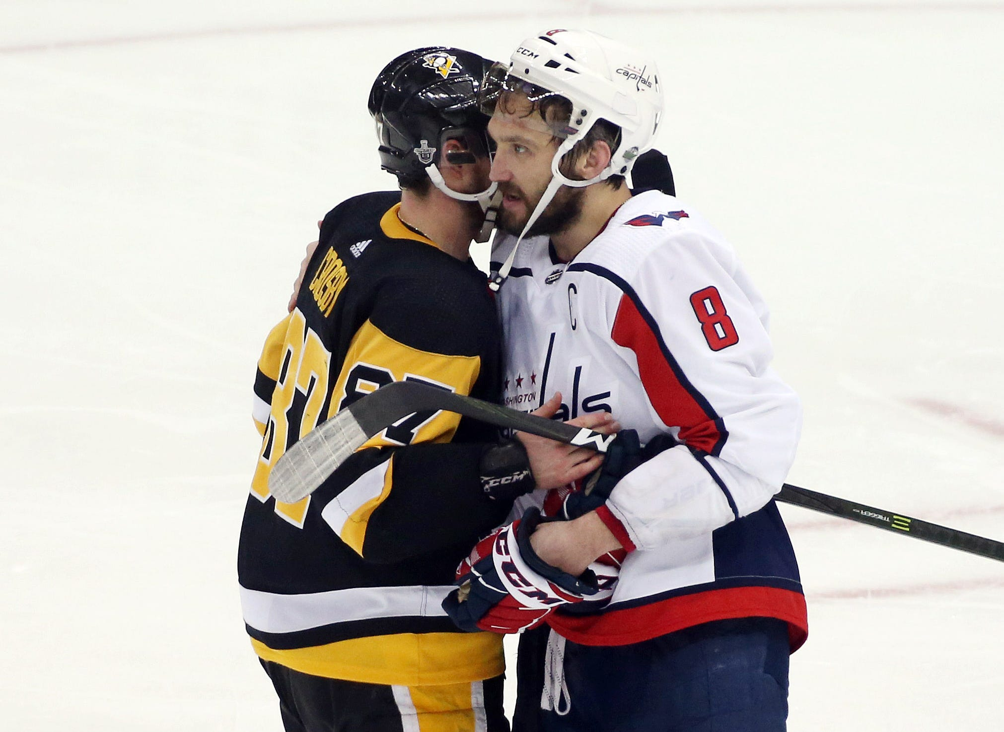 Pittsburgh Penguins center Sidney Crosby, left, and Washington Capitals left wing Alex Ovechkin embrace after game six of the second round of the 2018 Stanley Cup Playoffs at PPG PAINTS Arena in Pittsburgh. The Capitals won 2-1 in overtime to win the