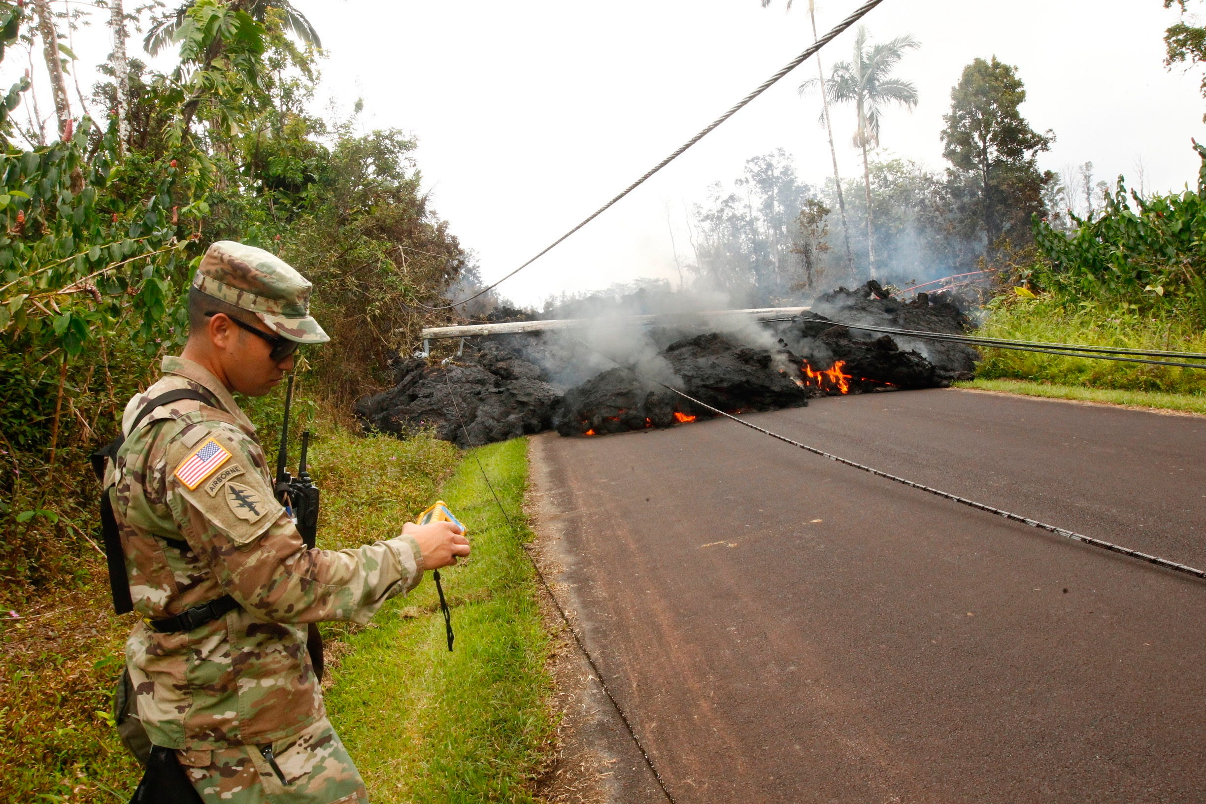 Lava continues to overrun Hookupu Street, May 7, 2018, in Pahoa, Hawaii. Hawaii's Kilauea volcano has destroyed homes and spewed lava hundreds of feet into the air, leaving evacuated residents unsure how long they might be displaced.