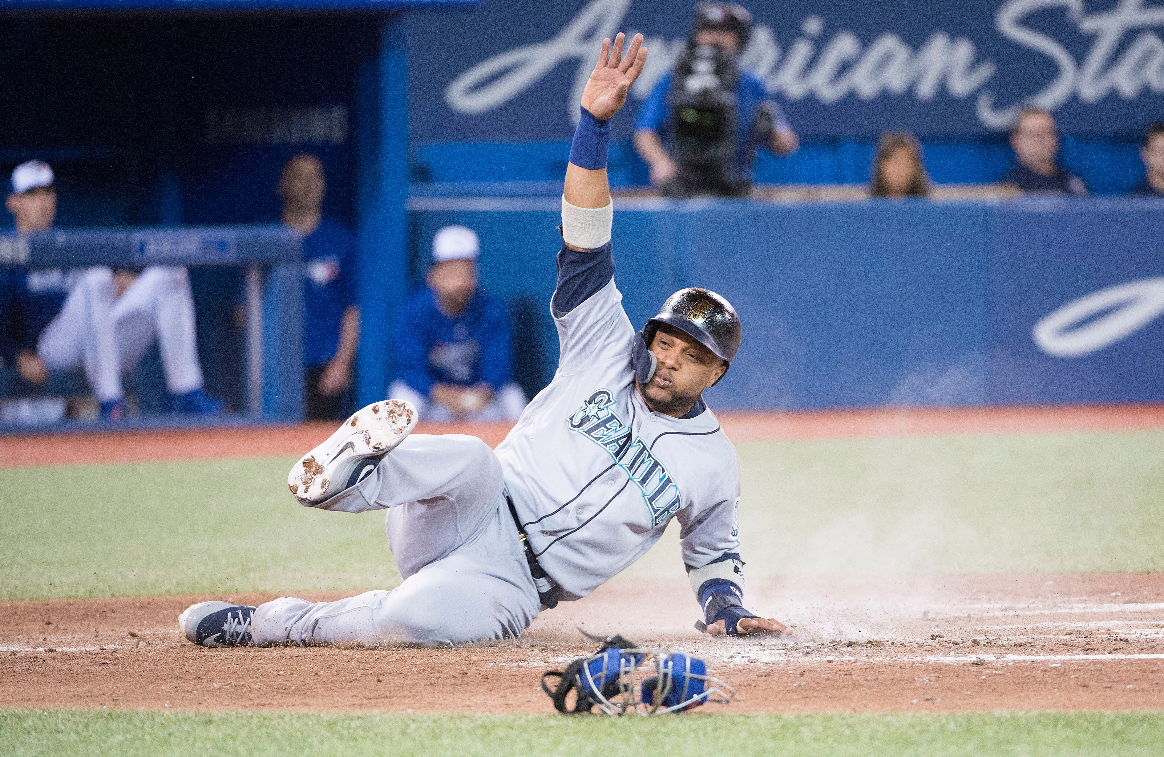 Seattle Mariners second baseman Robinson Cano slides into home scoring a run in the fifth inning during a game against the Toronto Blue Jays at Rogers Centre in Toronto.