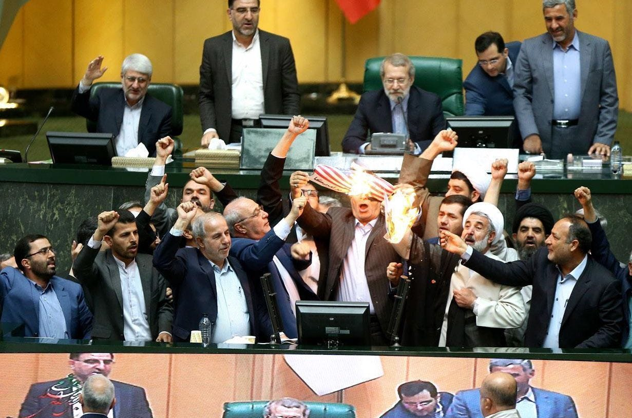 Iran lawmakers shout 'death to America,' burn U.S. flag after Trump nixes nuclear deal