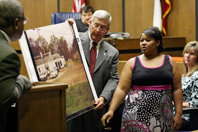 On June 14, 2010, in Greenwood, during Curtis Flowers' sixth trial for the Tardy Furniture murders, Clemmie Flemming points out to prosecutor Doug Evans, center, where she spotted Flowers on the morning of the Winona slayings on July 16, 1996.