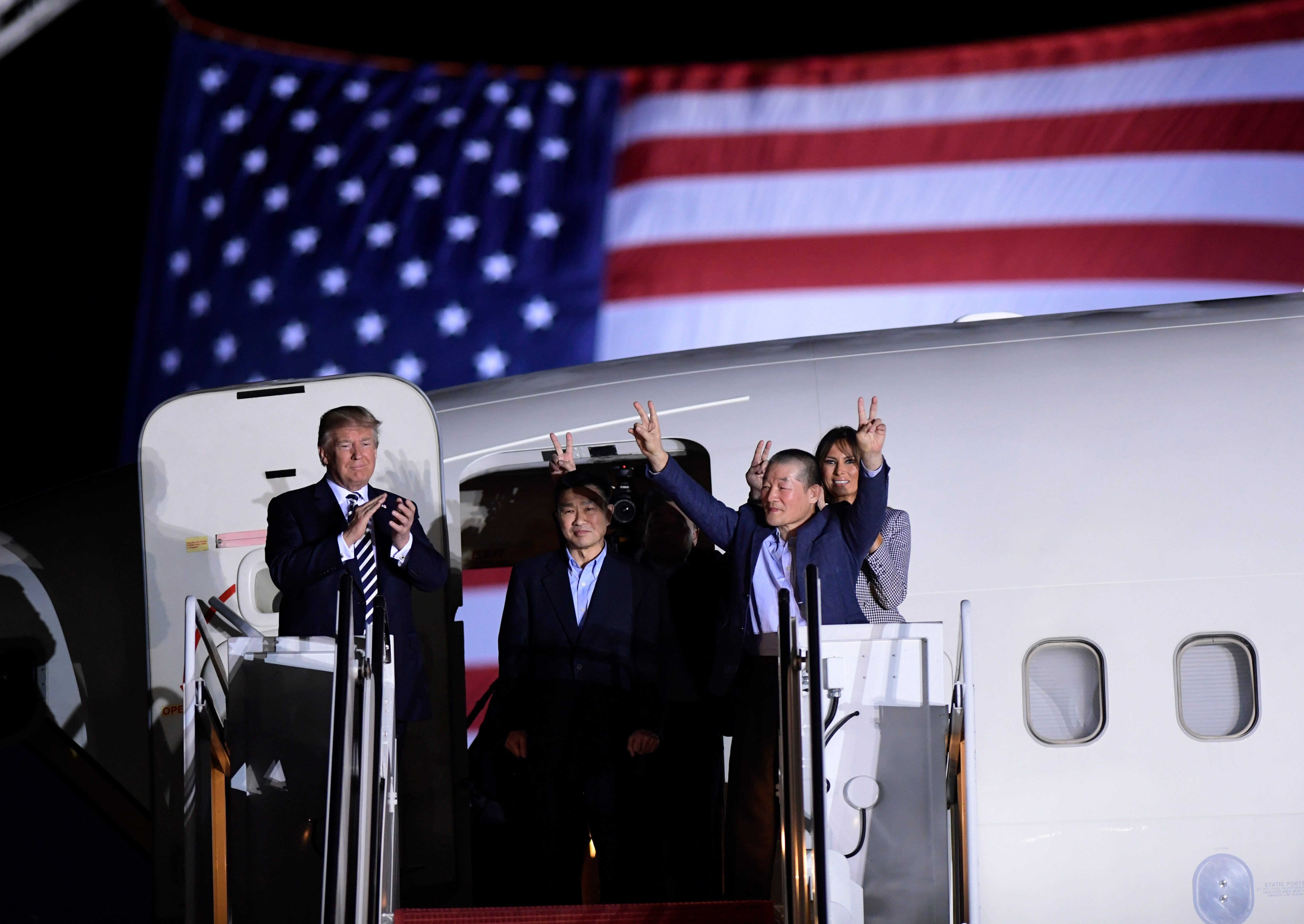 President Trump, from left, greets Tony Kim, Kim Hak Song, seen in the shadow, and Kim Dong Chul, three Americans detained in North Korea for more than a year, as they arrive at Andrews Air Force Base in Md., May 10, 2018. First lady Melania Trump al