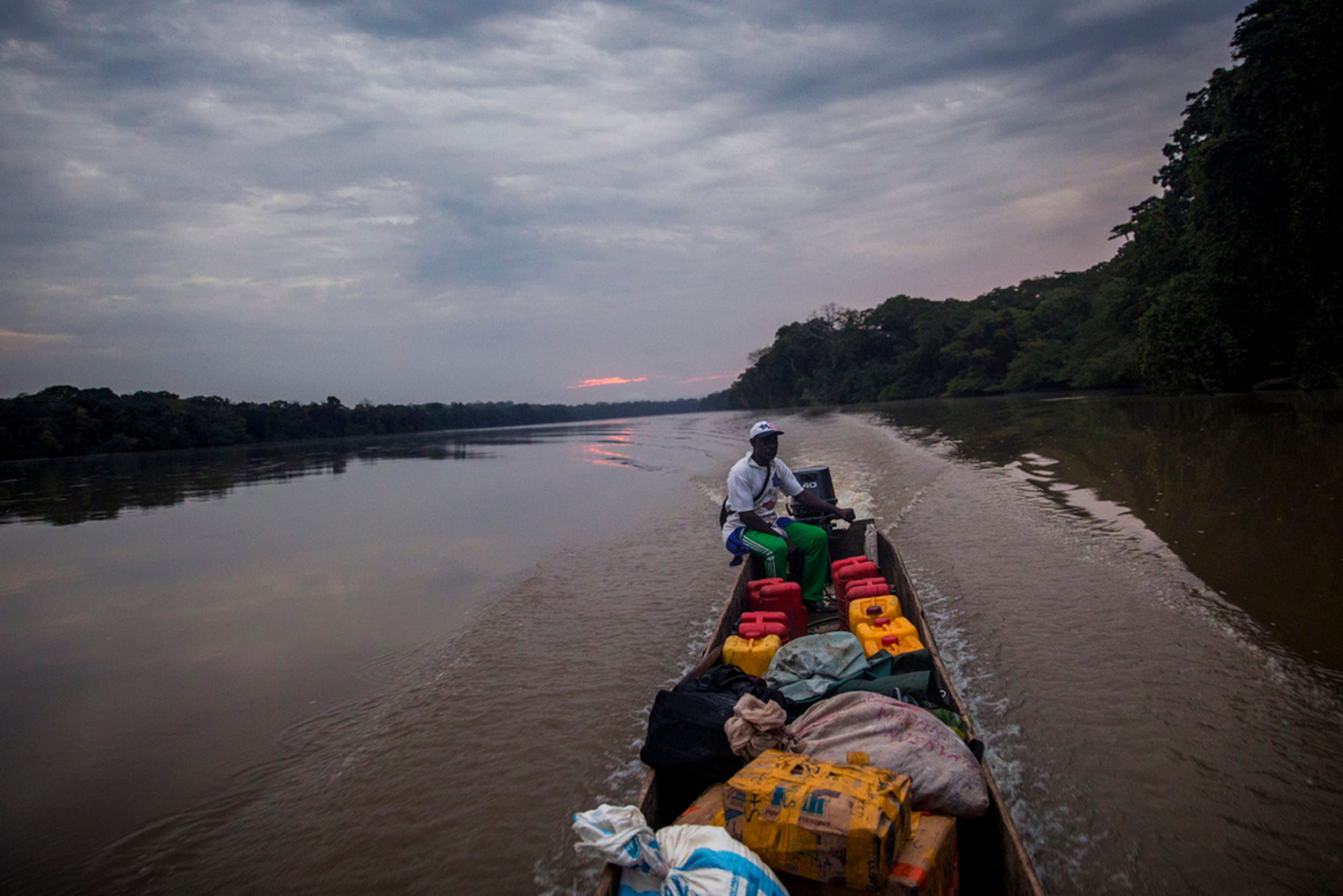 The sun slowly rises as we embark on our five-hour adventure down the Sangha River to the town of Ouésso.