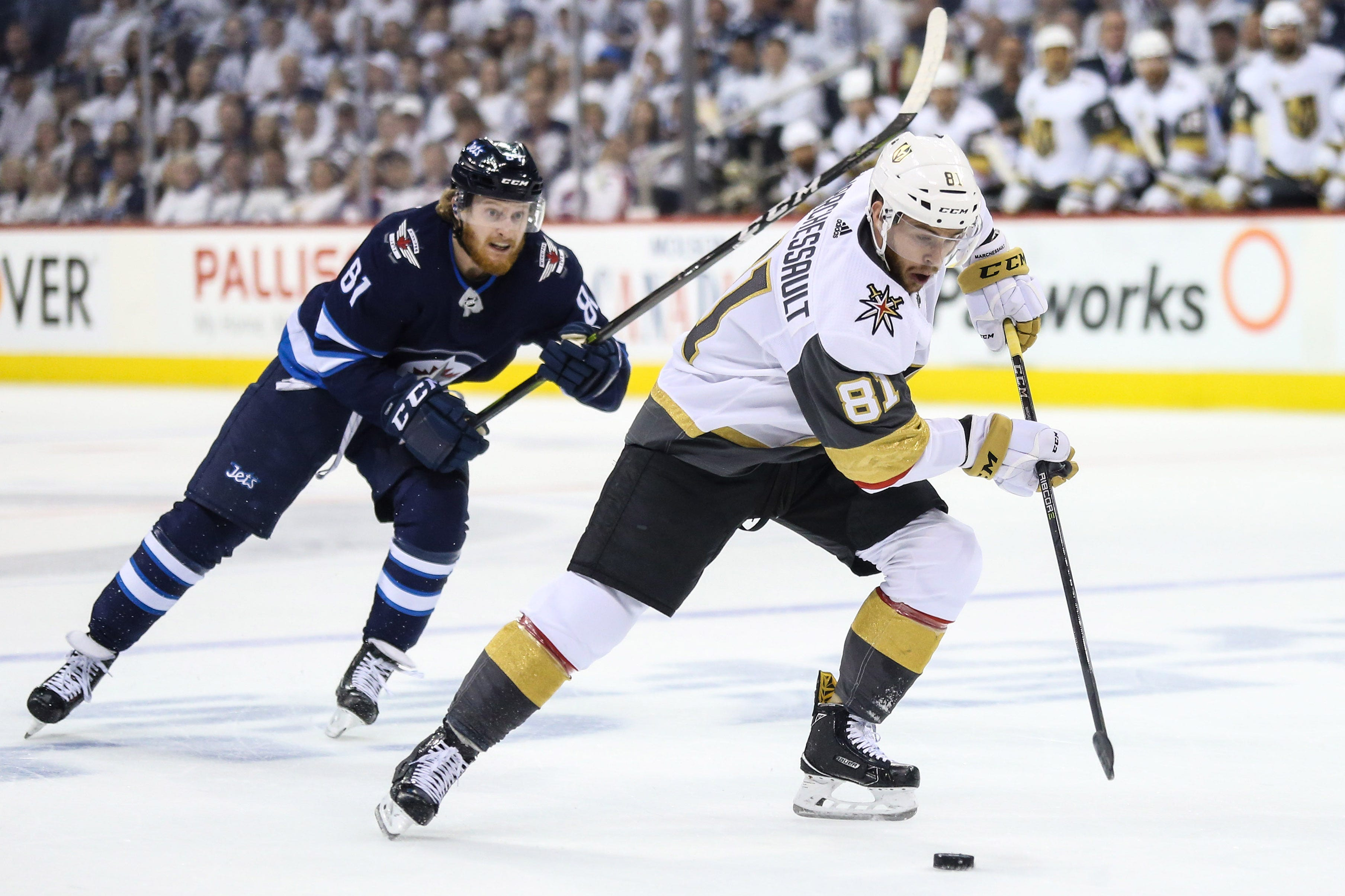 Vegas Golden Knights center Jonathan Marchessault skates with the puck past Winnipeg Jets left wing Kyle Connor to score a goal during the first period in game two of the Western Conference Final of the 2018 Stanley Cup Playoffs at Bell MTS Centre in