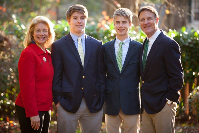 Susan Bayh stands with her sons, Beau and Nick Bayh, and her husband, Evan Bayh. The photo was taken when the Bayh twins turned 18.