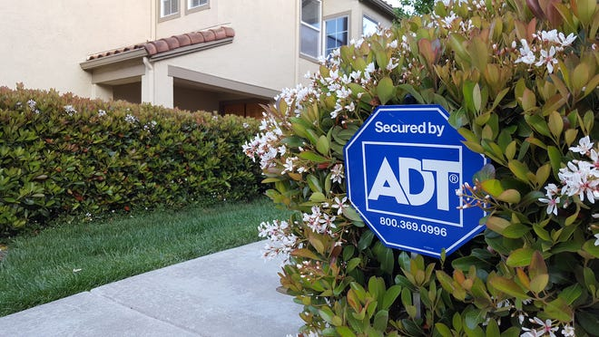 An ADT home security sign in front of a property (file photo).