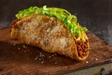 At Jimboy's Tacos, the Original Ground Beef Taco, the chain's flagship dish, features griddled shells dusted with Parmesan.