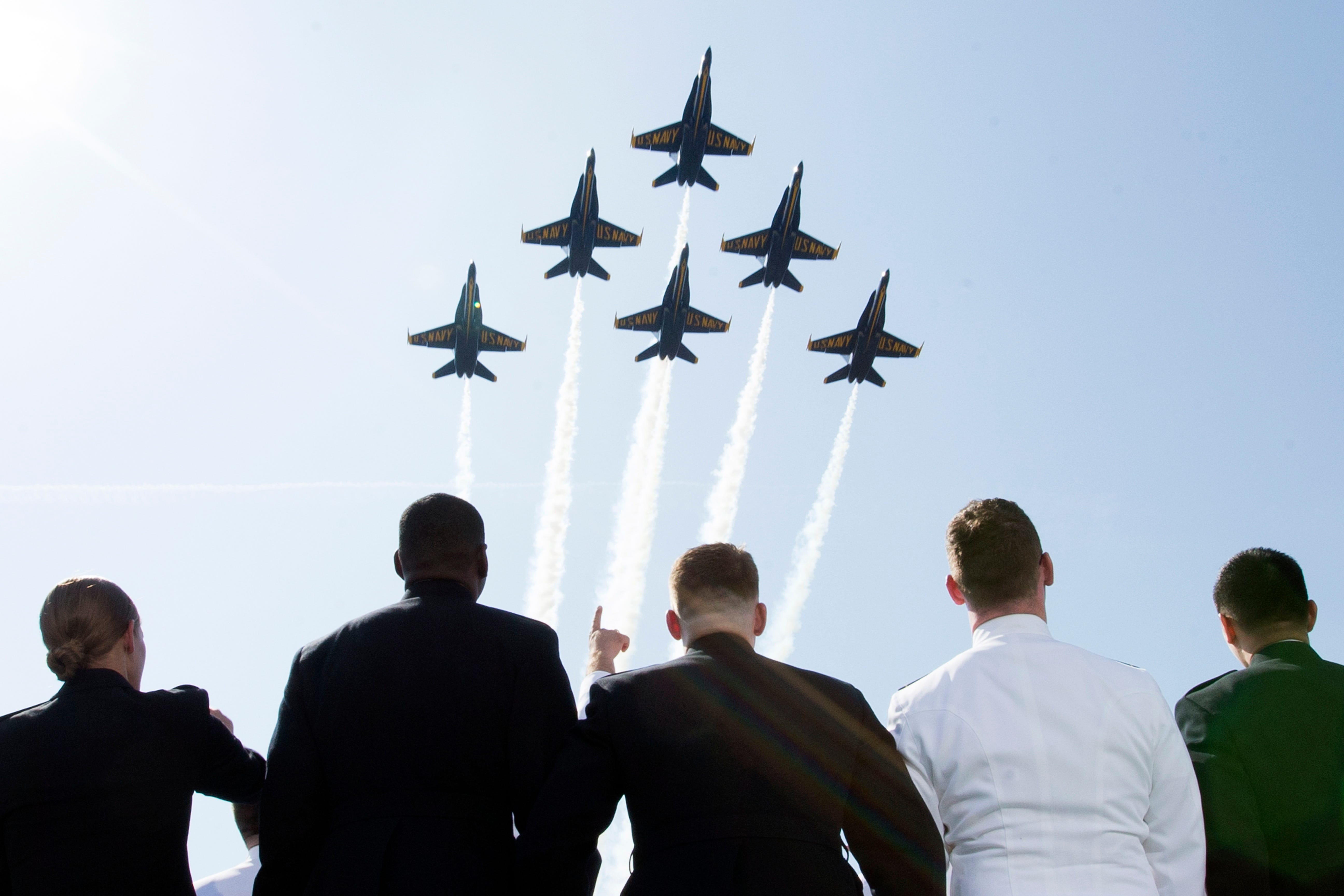 The Blue Angels fly over the the Class of 2018 midshipmen during the United States Naval Academy Graduation and Commissioning Ceremony, at Navy-Marine Corps Memorial Stadium in Annapolis, Md.