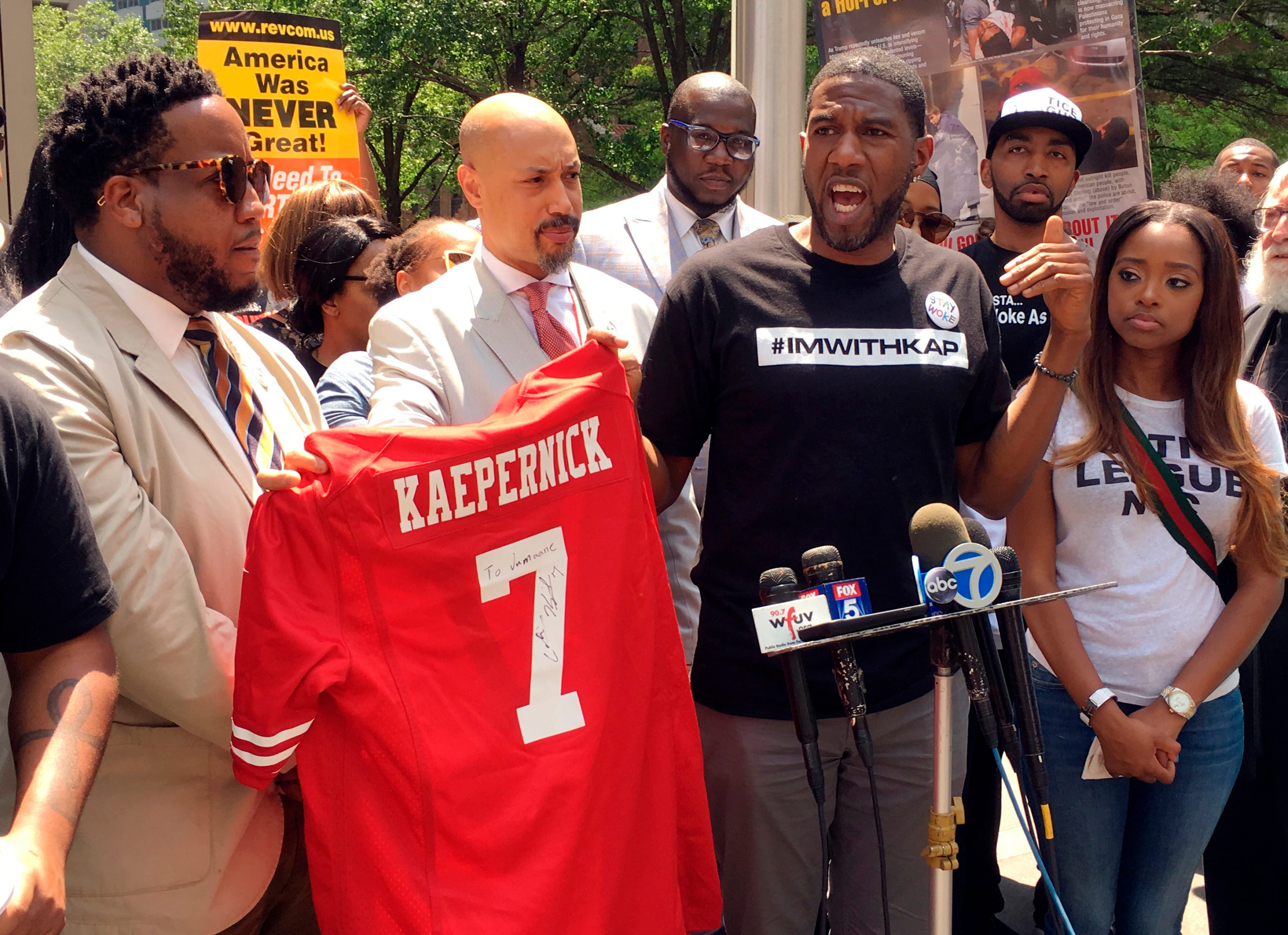 Civils rights activists rally outside of NFL headquarters