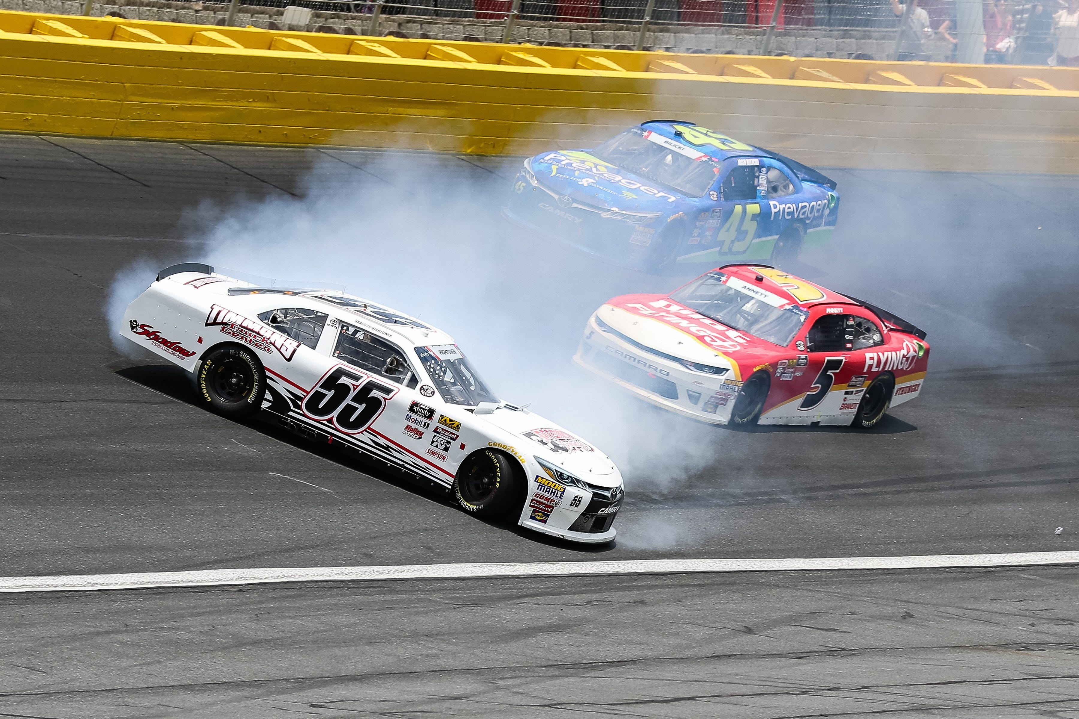 NASCAR Xfinity Series driver Brandon Hightower, left, slides in a one car spin during the Alsco 300 at Charlotte Motor Speedway.