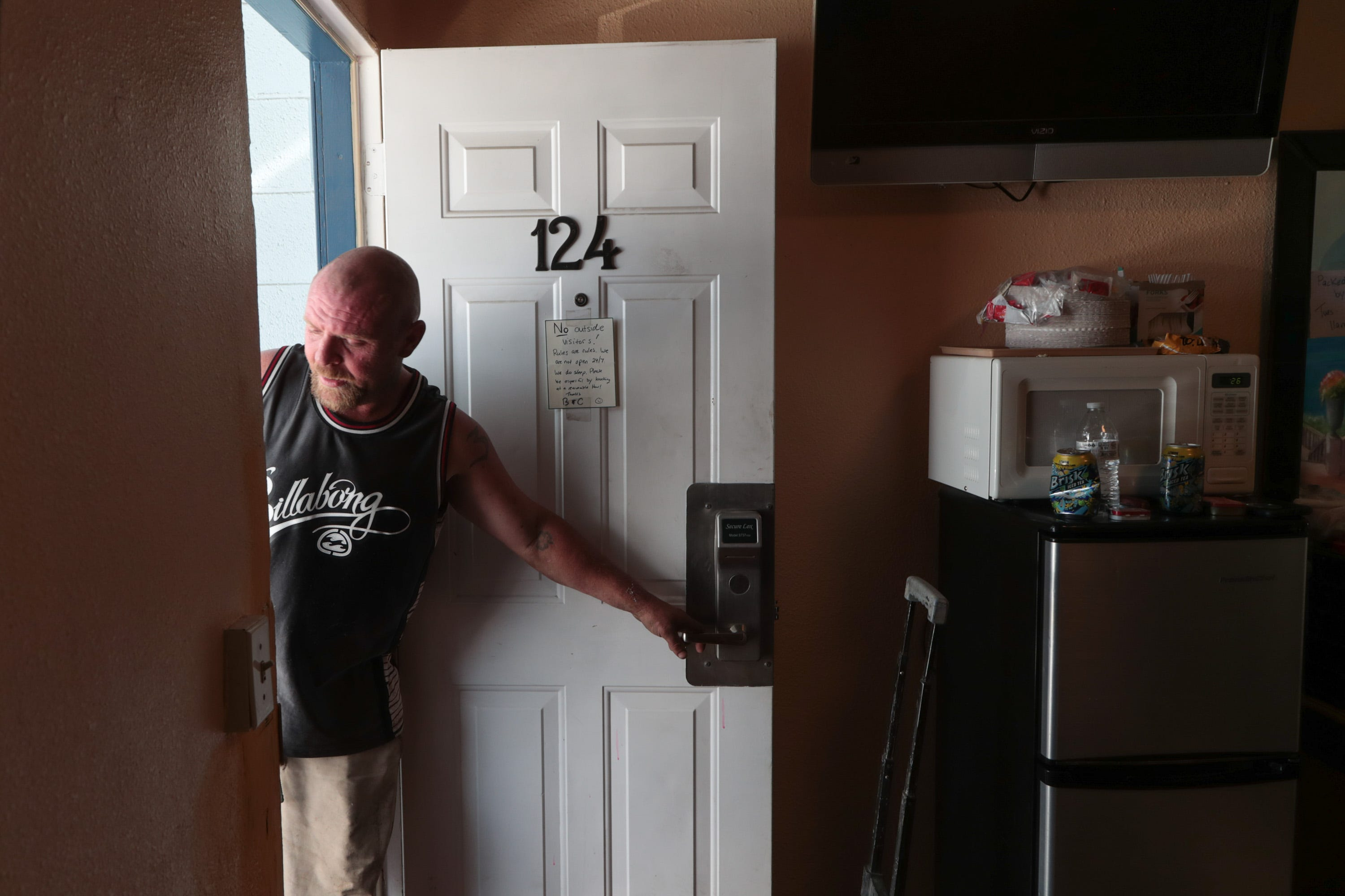 Bryan Hensley leaves the room he was sharing with his girlfriend at City Center Motel in Indio on May 29, 2018. Hensley and nearly 40 others were housed at the hotel after being evicted from Caltrans land in Coachella.