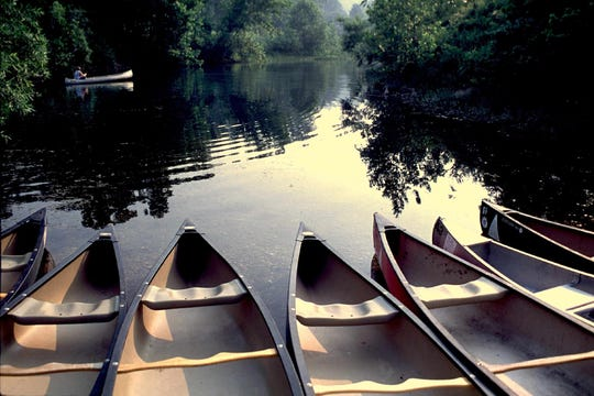 Reserved canoes wait to be occupied on the Jacks fork River.