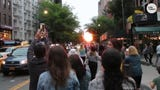 "People are stopping in the middle of the street to take photos of a phenomenon known as ""Manhattanhenge."""