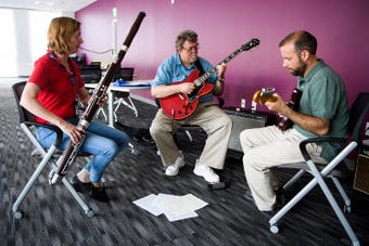 Greenville News Staff Ron Barnett, Anna Mitchell, and Nathan Gray perform an original song during a live Newsroom Session.