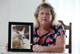 The death of her family's puppy spurred Holmdel woman to push for a stricter state law regulating pet shops. Now she says the law isn't working.
