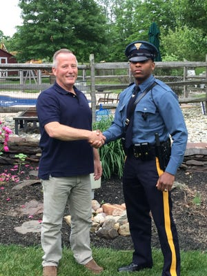 Matthew Bailly, left, and New Jersey State Trooper Michael Patterson were reunited Friday, June 1, 2018, when Patterson stopped Bailly for a minor motor vehicle violation in Kingwood Township, N.J. As a rookie cop, Bailly delivered Patterson 27 years earlier.