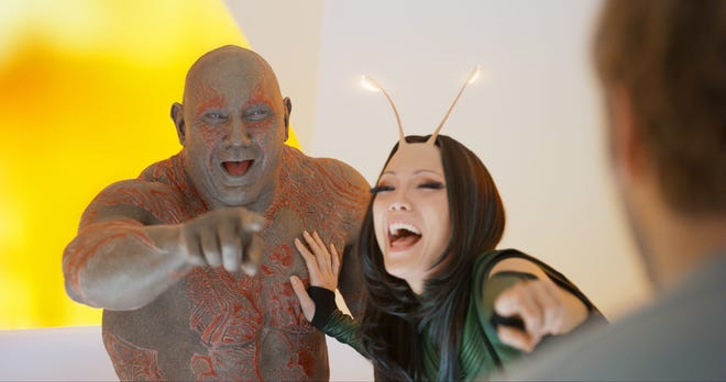 """Drax (Dave Bautista) and Mantis (Pom Klementieff) enjoy a laugh at Peter Quill's expense in """"Guardians of the Galaxy Vol. 2."""""""