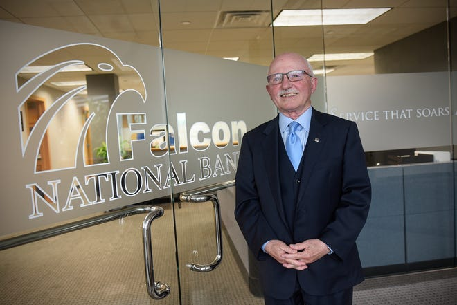 Falcon National Bank CEO John Herges stands at an entrance to the bank's downtown St. Cloud location Thursday, June 7, 2018.