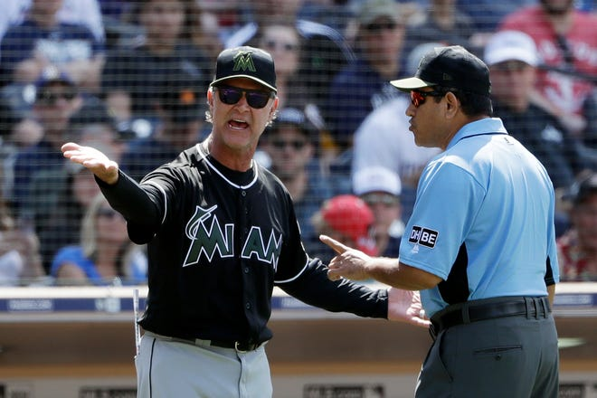 Miami Marlins manager Don Mattingly, left, has a word with third base umpire Alfonso Marquez during the seventh inning of a baseball game against the San Diego Padre, Monday, May 28, 2018, in San Diego. Mattingly will be leading his Miami Marlins into the 2020 playoffs.
