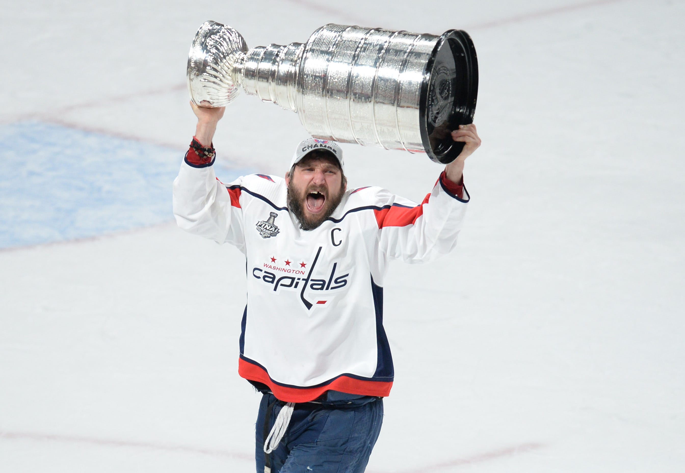 Finally a champion, Capitals star Alex Ovechkin won't let the Stanley Cup out of his sight