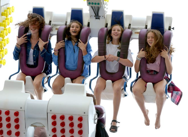 Teens get inverted and spun about on the Freak Out carnival ride at the St.John Vianney Parish Festival in Brookfield in 2018. This year's event is June 7-9.