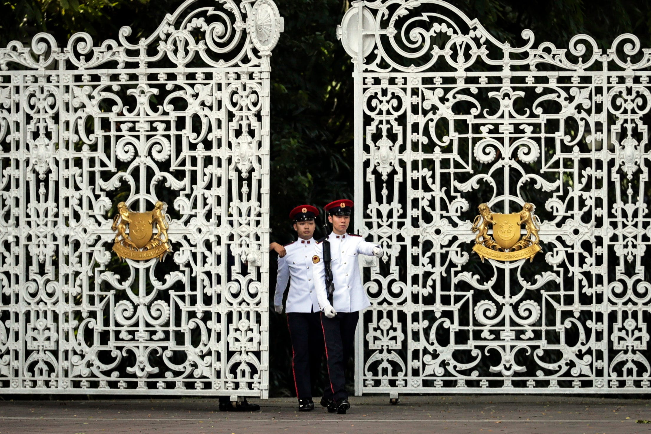 Singapore military personnel patrol in front of the gate of the Istana Presidential Palace, where North Korean Leader Kim Jong-un and Singapore Prime Minister Lee Hsien Loong will meet in Singapore. The North Korean leader is scheduled to meet on wit