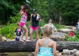 Wesselman Woods communication director Elaine Edwards offers insight to the nations largest nature playscape located in Wesselman Woods.