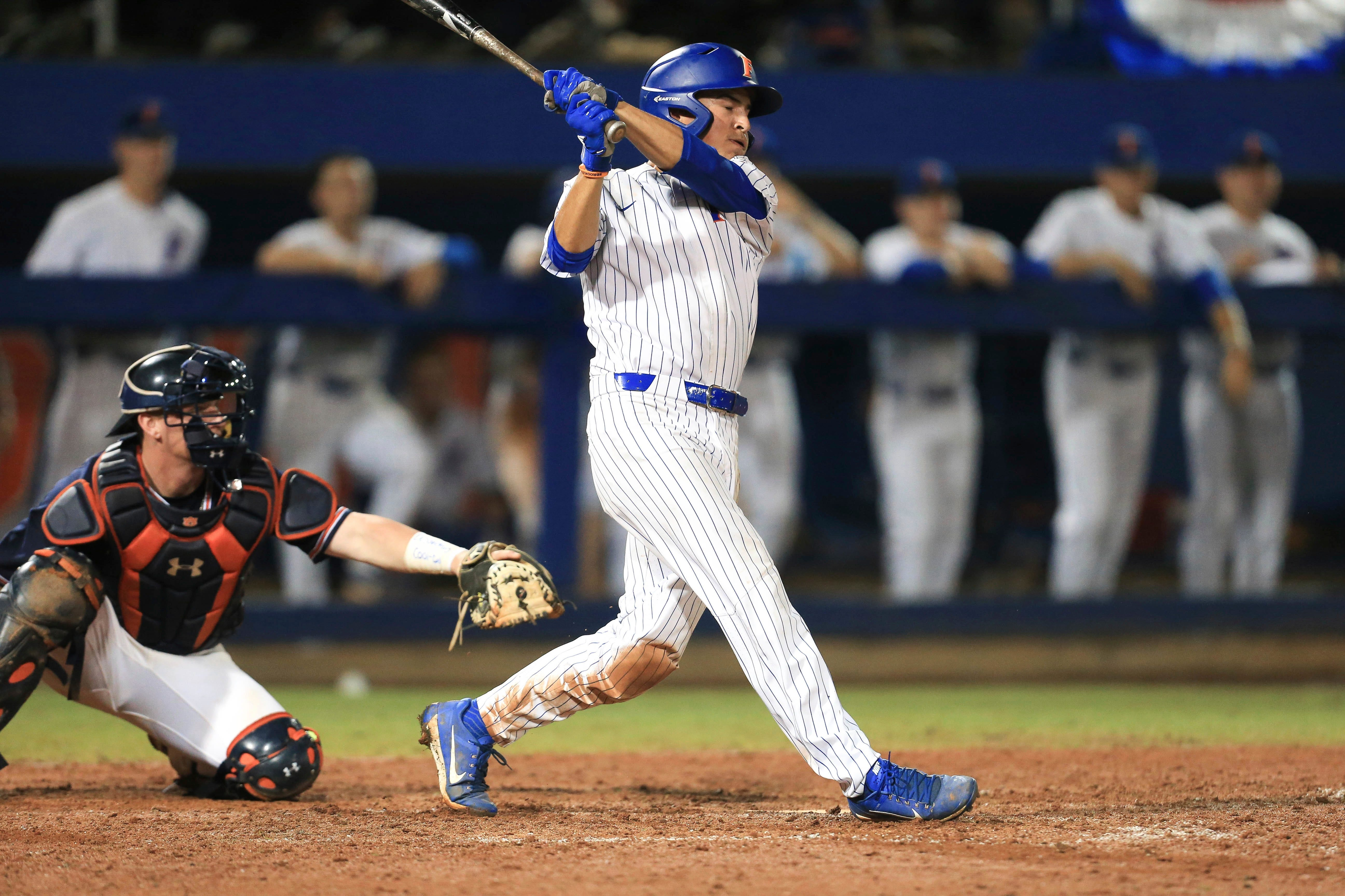 Florida returns to College World Series with walk-off home run off Auburn outfielder's glove