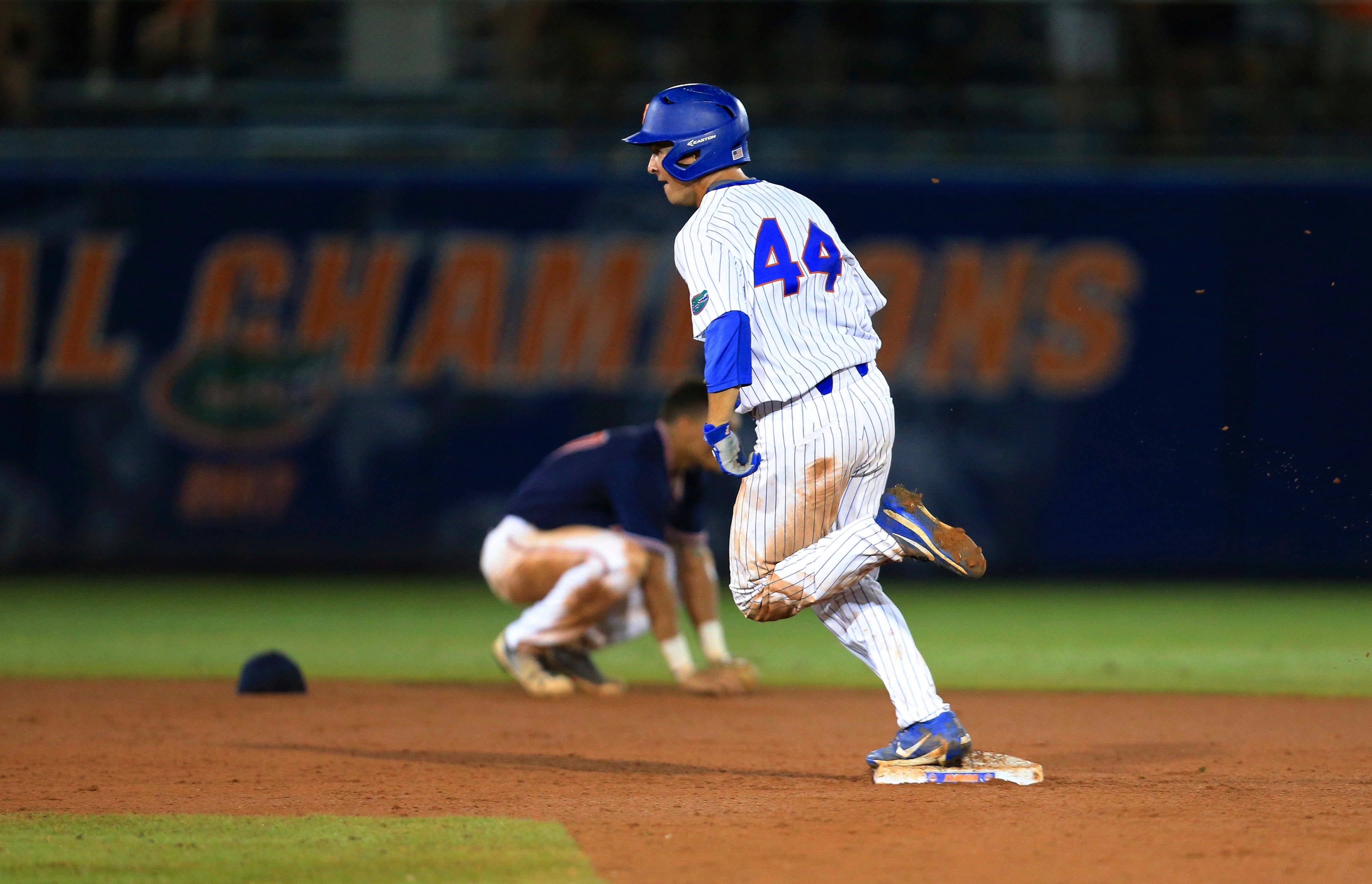 Langworthy's homer off glove lifts Florida back to Omaha