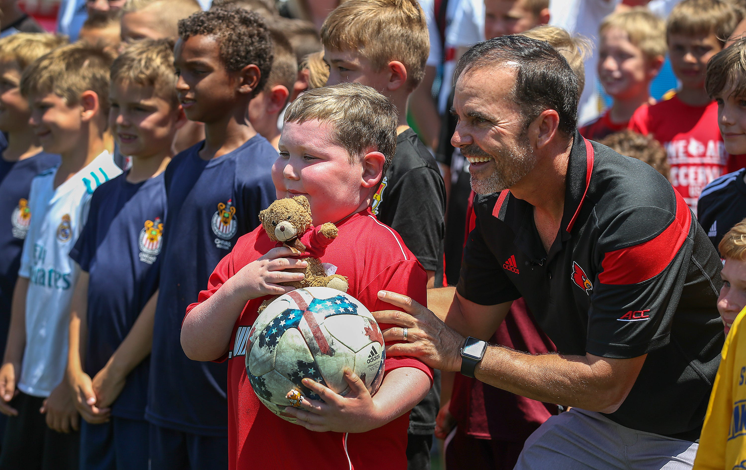 3146cfe69c7 University of Louisville men s soccer team brings joy to 6-year-old boy with