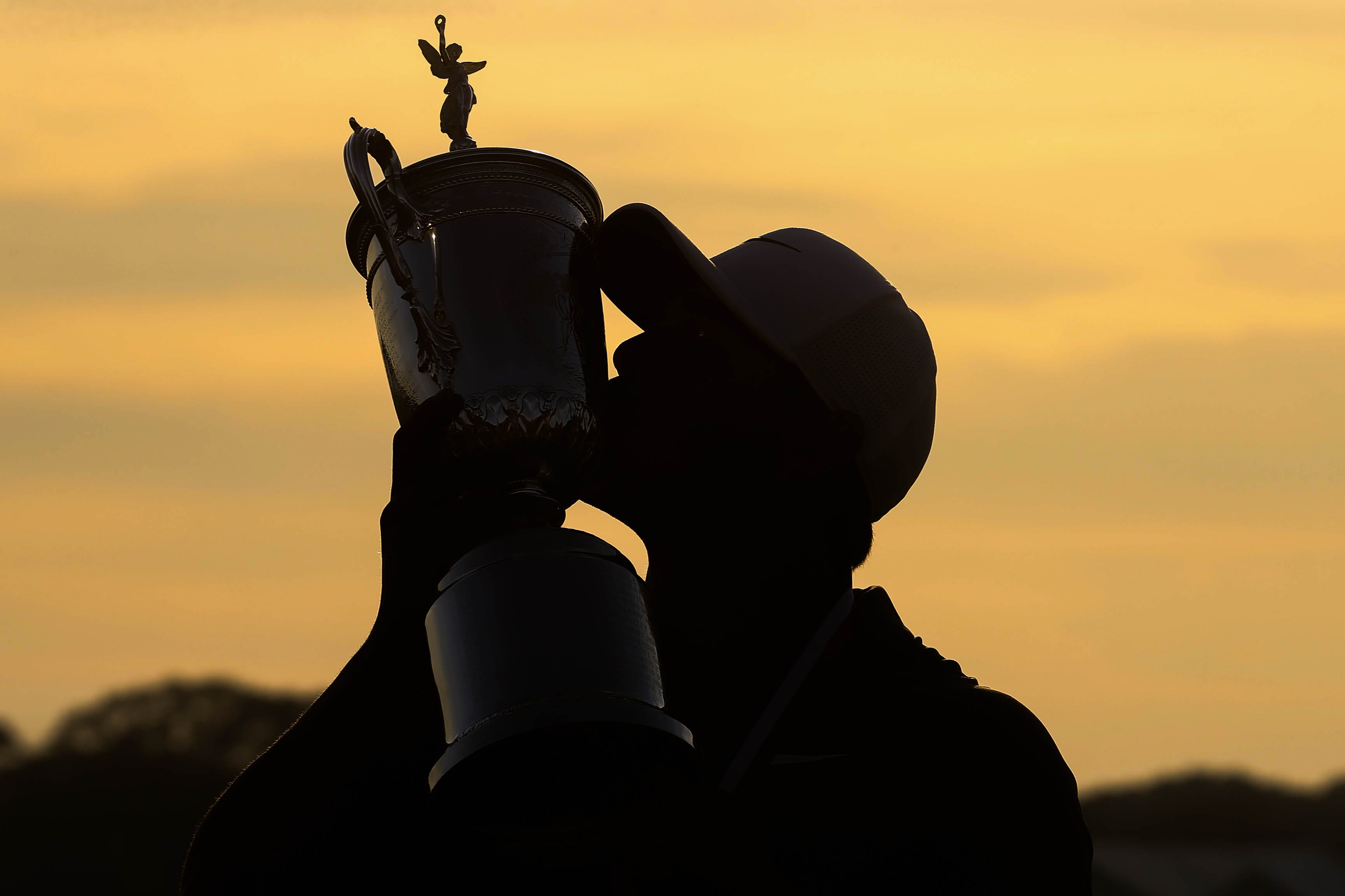 Brooks Koepka kisses the trophy after winning the U.S. Open golf tournament in Southampton, N.Y.