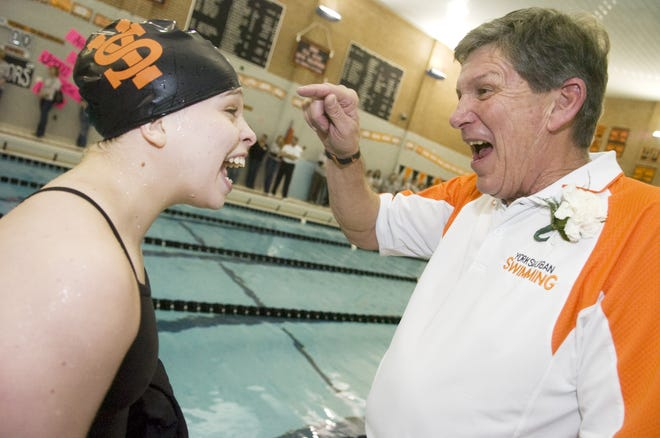 In this YDR file photo from 2009, York Suburban's Dick Guyer talks with swimmer Jessica Hawk during the final home meet during Guyer's 41-year run as a head coach at Suburban.