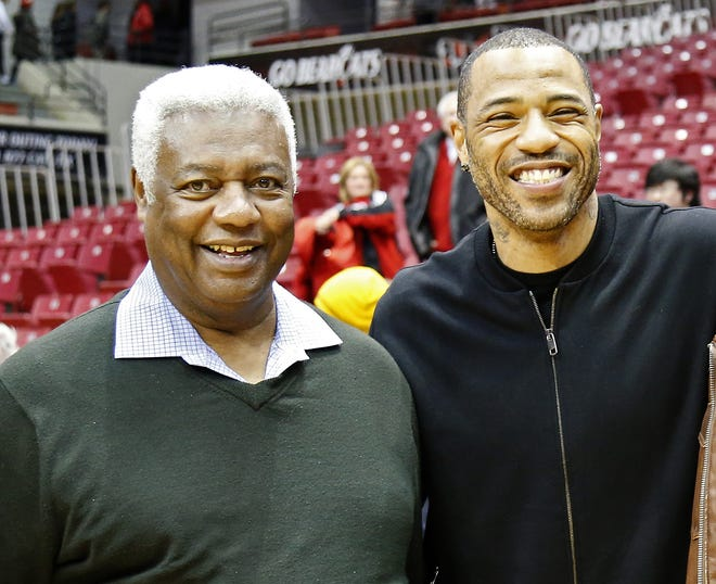A pair of No. 1 overall draft picks, former Bearcats greats Oscar Robertson and Kenyon Martin pose for a photo after the game between the Cincinnati Bearcats and the Memphis Tigers at Fifth Third Arena on Thursday, Jan. 21, 2016.