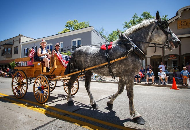 Lena Lensmith of Oconomowoc pilots the Hoof Beats Express horse-drawn carriage during the 2016 Hartland's Hometown Celebration parade. This year's celebration runs Friday through Sunday,, June 29-July 1, with the parade at 1:30 p.m. Sunday.