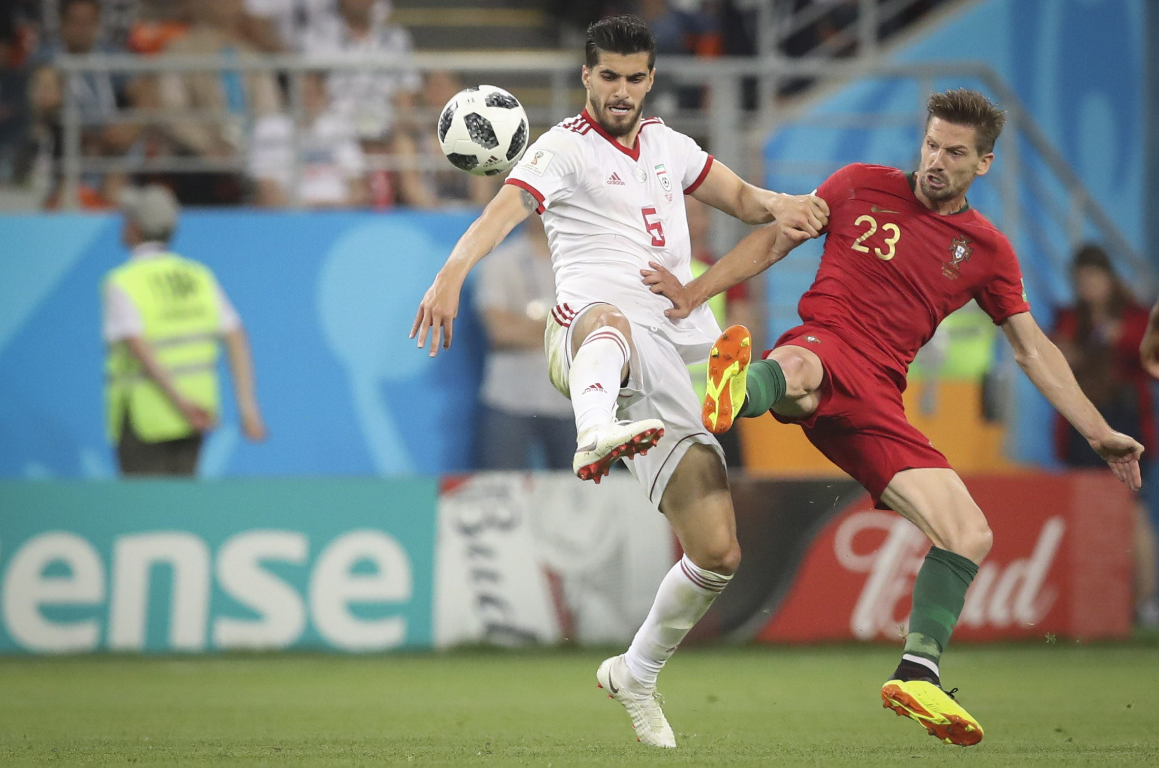 Portuguese player Adrien, right, and Iranian player Saeid Ezatolahi vie for the ball in Group B play during the FIFA World Cup 2018 at Mordovia Arena in Saransk, Russia.