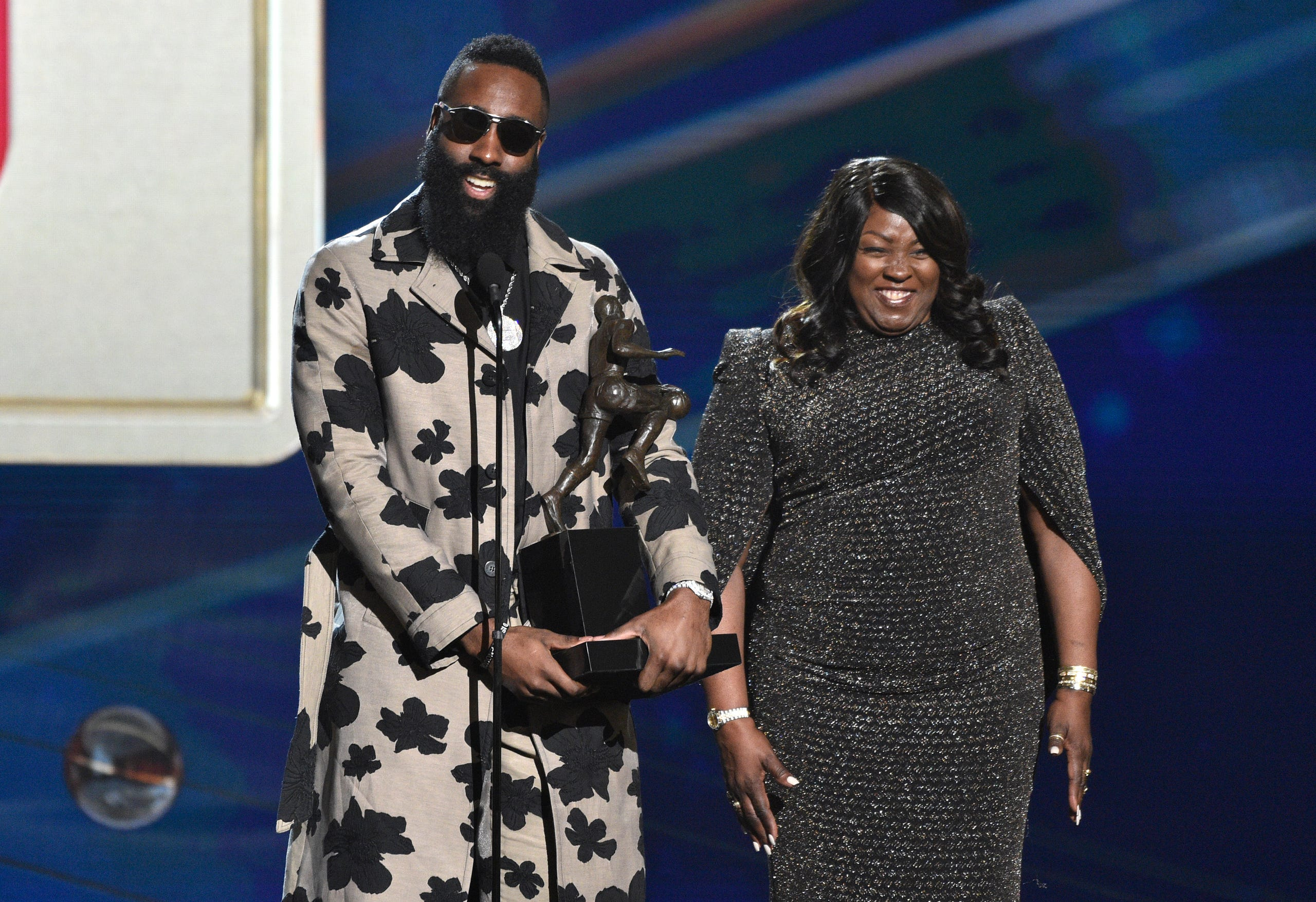 0b12c6218d0 James Harden accepts the Most Valuable Player award as his mother Monja  Willis looks on.