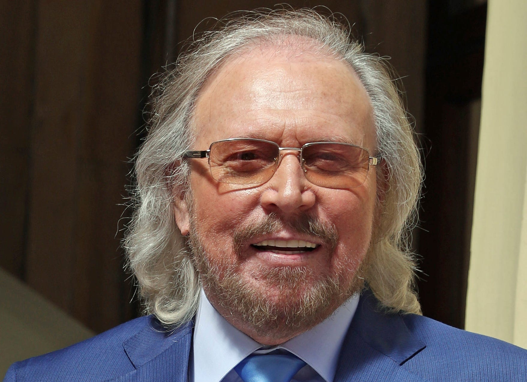Knight fever: He's Sir Barry Gibb as last of Bee Gees brothers is knighted at palace