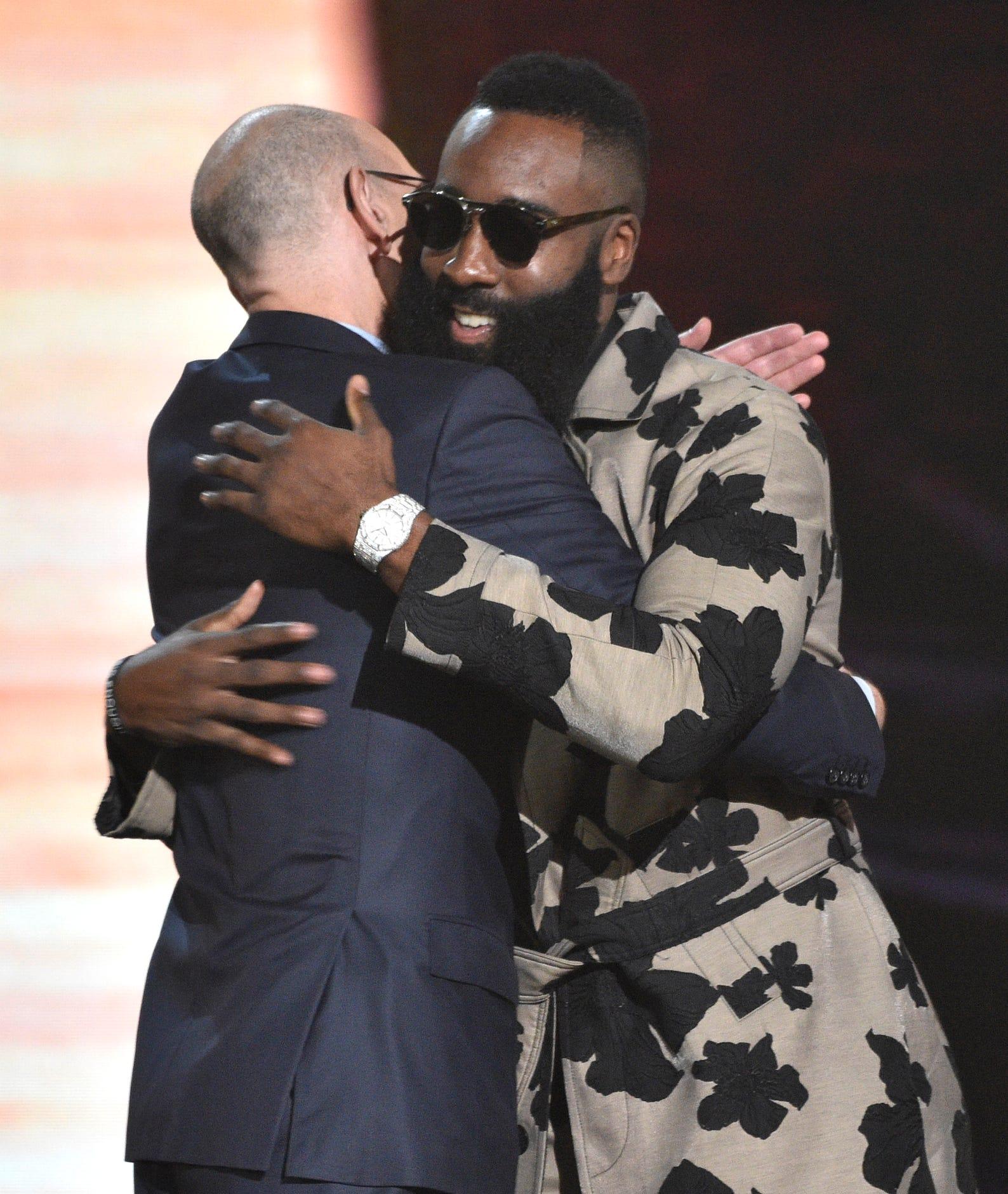 e58947464db NBA commissioner Adam Silver presents the MVP award to James Harden.