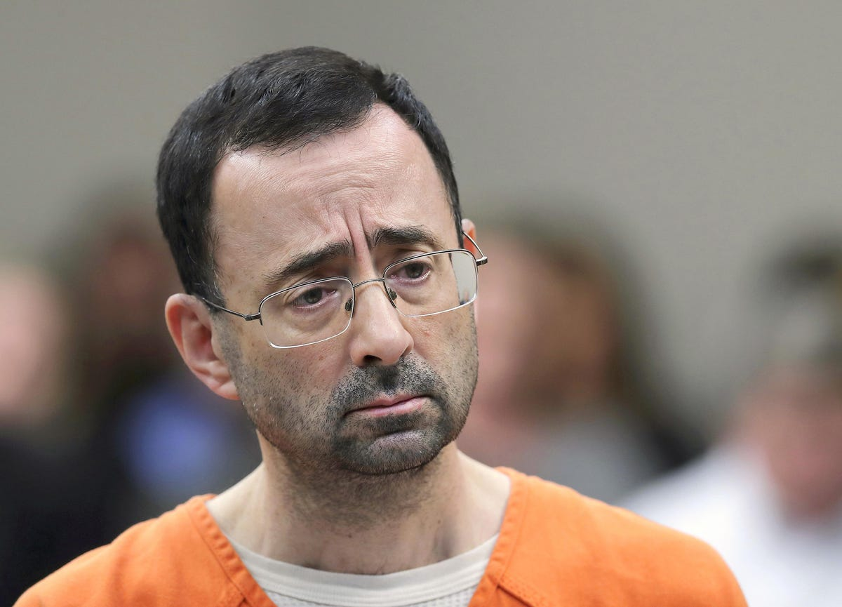 Nassar assaulted in prison, court filing says