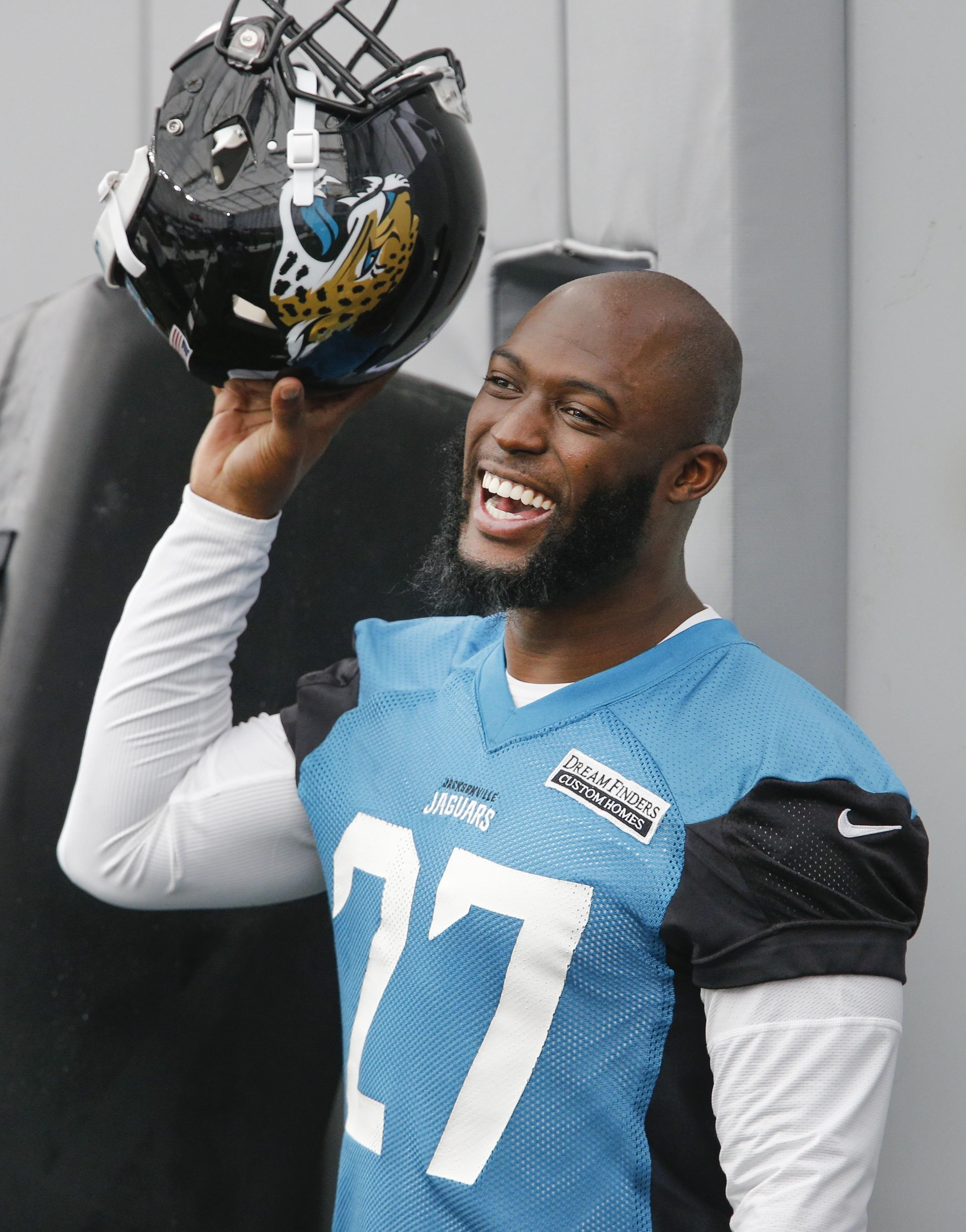 Jaguars' Leonard Fournette helps an LSU student pay her tuition