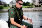 TWRA Officer Jeff Roberson shares four boat safety tips with KNS reporter Ryan Wilusz on Saturday, July 7, 2018.