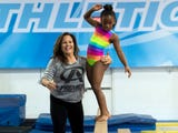Gymnast Lisa Savage talks about her love for coaching gymnastics to children